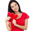 Attractive girl holding two hearts — Stock Photo #51025153