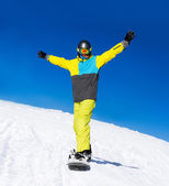 Snowboarder sliding down the hill, — Stock Photo