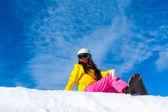 Snowboarder sitting on mountain slope — Stock Photo