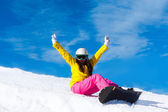 Snowboarder sitting on mountain slope — Foto Stock
