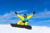 Snowboarder sitting on snow mountain slope — Stock Photo