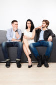 Woman  flirting with two man — Stock Photo