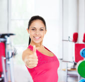Fitness woman shows thumb up — Stock Photo