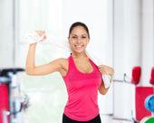 Woman in gym smiles — Stock Photo