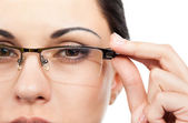 Businesswoman face wearing eye glasses — Stock Photo
