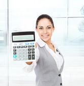 Businesswoman showing calculator — Stock Photo
