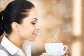 Business woman with cup of coffee — Stock Photo
