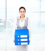 Bored businesswoman holds folder — Stock Photo