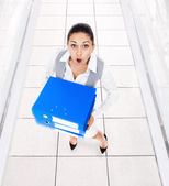 Businesswoman surprised scared with folders — Stock Photo