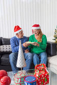 Senior couple give christmas present — Stock Photo
