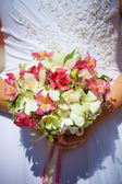 Wedding bunch in hands — Stock Photo