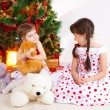 Girls at a New Year tree - Foto Stock