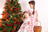 Girls at a New Year tree — Stock fotografie