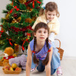 Girls at a New Year tree - Stock Photo