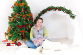 Woman with a New Year tree — Stock Photo