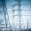 High voltage towers — Stockfoto