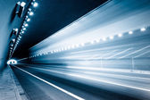 Motion truck go through the tunnel — Stock Photo