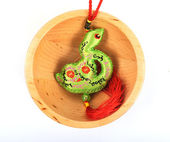 Chinese snake in wood bowl mean good luck — Stock Photo