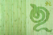 Chinese Year of Snake on bamboo background — Stock Photo