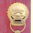Traditional chinese temple with guardian door knockers — Stock Photo #14047601