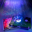 Computer harddisk and heads on technology fiber optics background — Stock Photo