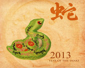 2013 year of the snake with paper background — Stock Photo