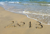 Number 2013 on the beach of sunrise — Stock Photo