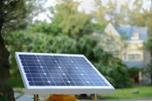 Solar panels with rural residence — Stock Photo