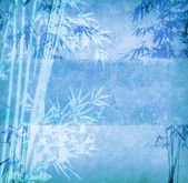 Bamboo on old grunge antique paper texture — Stock Photo