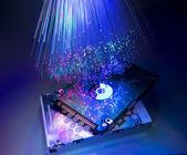 Computer harddisk and heads on technology fiber optics background — Stock Photo