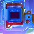 CCD sensor on a card of digital camera with fiber optical background - Stock Photo