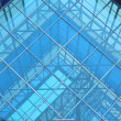 Contemporary office building blue glass wall detail — Stock Photo #15691823