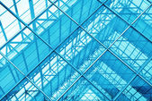 Contemporary office building blue glass wall detail — Photo
