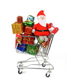 Shopping cart with Christmas gifts and presents. — Stock Photo