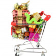 Shopping cart fill with Christmas Decorations background and Cute Christmas snake — Foto de Stock