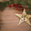 Christmas background with golden star decoration — Stock Photo
