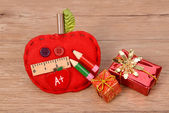 School ornaments on wood background — Stock Photo