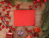 Red card with Christmas Decorations — Stock Photo