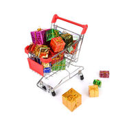 Shopping cart with Christmas gifts and presents — Stock Photo