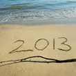 "New year background with ""2013"" drawn in the sand — Stock Photo"