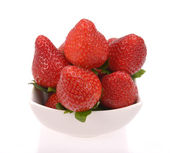 Strawberries in white bow — Stock Photo