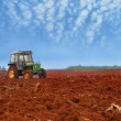 Tractor cultivatin soil ready for seeding in spring — Stock Photo