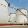 Big Industrial oil tanks in a refinery — Stock Photo