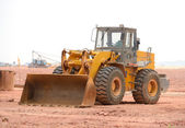 Bulldozer on a building site — Stock Photo