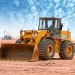 Bulldozer on a building site - Stock Photo