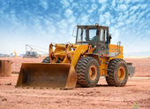 Bulldozer on a building site — Stockfoto