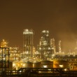 Oil refinery working at night — Stock Photo #23729833
