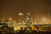 Oil refinery working at night — Stock Photo