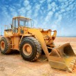 Stock Photo: Bulldozer on building site