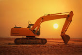 Excavator loader machine during earthmoving works outdoors — Stock Photo